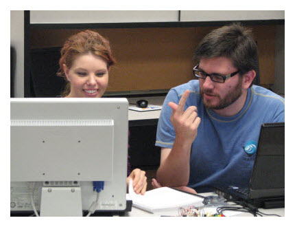 Two Parallax Educators Course attendees learn microcontroller programming