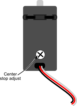 Location of center point adjustment control on side of servo housing
