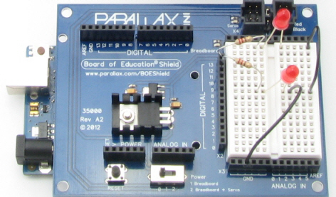 Board of Education Shield with two red LED circuits built onto its breadboard