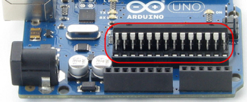 Digital and analog pins on an Arduino Uno module, close-up