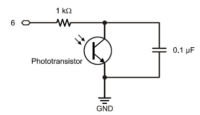 Phototransistor charge-transfer or QT circuit, with a 1 k-ohm resistor connected in parallel with the phototransistor