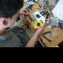 Testing voltage with a multimeter.