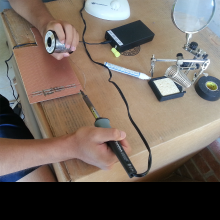 Soldering the circuit board.